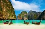 Tropical beach, traditional long tail boats, famous Maya Bay, Thailand